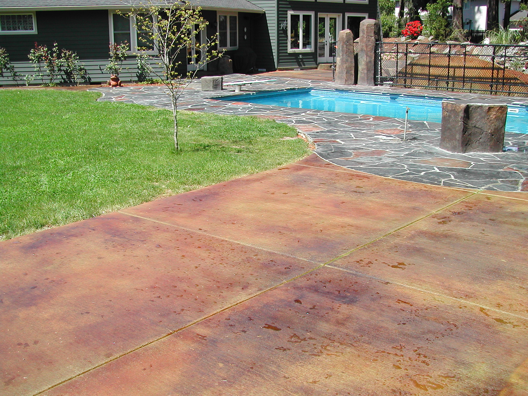slate and acid stain pool area | indy construction, llc
